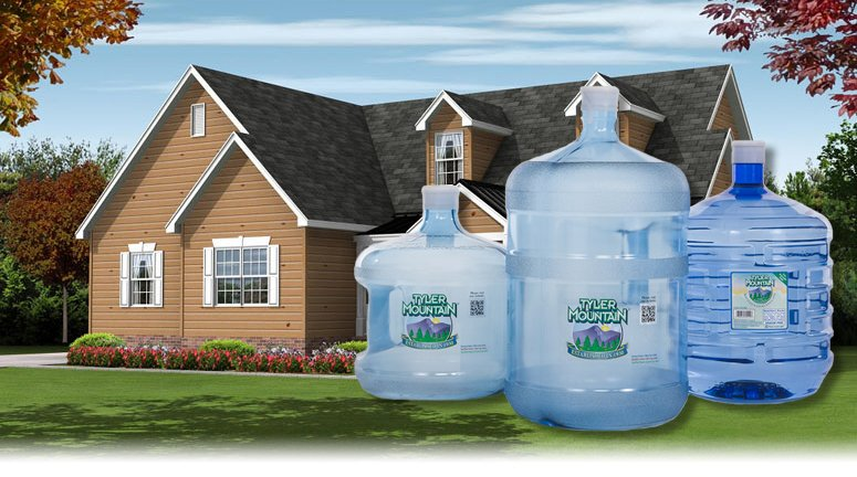 large bottles in front of a house