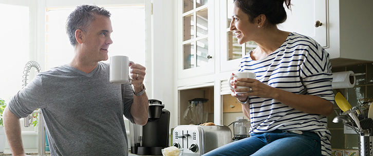 couple in kitchen drinking coffee tyler mountain water coffee single serve keurig